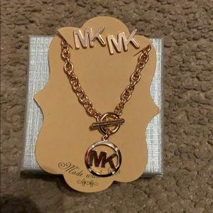 Mk earrings and bracelet